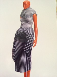 Rei Kawakubo/ Comme des Garcons Top and skirt of stretch nylon/ polyurethane plain weave printedgingham checks; down pads Spring/ Summer 1997